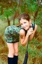 Beauty teen girl with gun Royalty Free Stock Photo