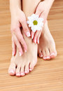 Beauty treatment of a female feet and hands Royalty Free Stock Photo