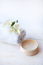 Beauty treatment , jasmin flowers and cosmetics   on white wooden table Royalty Free Stock Photo