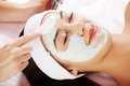 Beauty treatment in spa salon woman with facial clay mask Royalty Free Stock Images