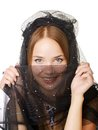 Beauty veiled girl beautifull portrait covered in a black veil Royalty Free Stock Photos