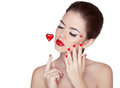 Beauty vogue style fashion model girl with long lushes manicure manicured nails and red lipstick isolated on a white background Royalty Free Stock Photos