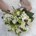 Beauty wedding bouquet of yellow and cream roses in a bride hands retro style Royalty Free Stock Image