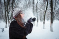 Beauty winter girl blowing snow in frosty winter park flying snowflakes joyful young redhead woman having fun Royalty Free Stock Image