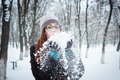Beauty winter girl blowing snow in frosty winter park flying snowflakes joyful young redhead woman having fun Stock Photos