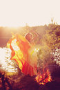 Beauty witch in the woods near the fire. Magic woman celebrating Royalty Free Stock Photo