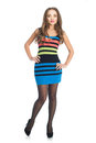Beauty woman in colored stripe dress over white background Royalty Free Stock Image