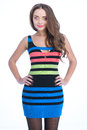 Beauty woman in colored stripe dress over white background Royalty Free Stock Photography