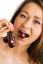 Beauty woman eat cherries Stock Photography