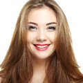 Beauty woman face. Young girl smiling. Isolated on white backgro Royalty Free Stock Photo