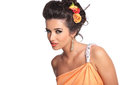 Beauty woman giving a sensual look to the camera elegant wearing flowers in her hair and nice makeup Royalty Free Stock Photo