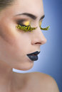 Beauty woman with long yellow lashes and black lips on blue background Stock Image
