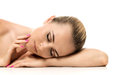 Beauty woman lying down spa young girl eyes closed on camera isolated on white background relax and relaxation on the salon Royalty Free Stock Images