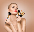 Beauty woman with makeup brushes Royalty Free Stock Photo