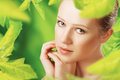 Beauty woman and a natural skin care in green herbal background Royalty Free Stock Photos