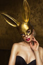 stock image of  Beauty woman over gold background