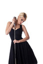 Beauty woman pin-up portrait with microphone Stock Image