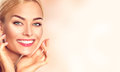 Beauty woman portrait. Beautiful spa girl touching her face Royalty Free Stock Photo