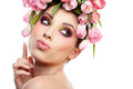 Beauty woman portrait with wreath from flowers on head over whit white background Stock Photo