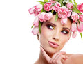 Beauty woman portrait with wreath from flowers on head over whit white background Stock Photos