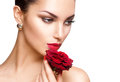 Beauty woman with red rose isolated on white background Stock Photos