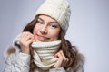 Beauty woman in scarf and hat on gray background Royalty Free Stock Image