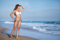 Beauty woman on sea beach in bikini Stock Photography