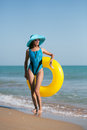Beauty woman on sea beach in bikini Royalty Free Stock Image