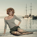 Beauty woman on sea with ship Stock Image