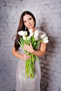 Beauty Woman with Spring Flower bouquet Royalty Free Stock Photo
