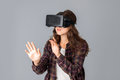 Beauty woman testing virtual reality helmet Royalty Free Stock Photo