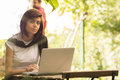 Beauty woman using laptop sitting at an outdoor coffee shop Royalty Free Stock Photo