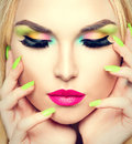 Beauty woman with vivid makeup and colorful nail polish Royalty Free Stock Photo