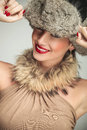 Beauty woman wearing a fur hat and smile Royalty Free Stock Photo