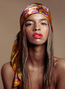 Beauty young afro american woman in shawl on head Royalty Free Stock Photo