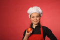 Beauty young cook with apple portrait of Royalty Free Stock Photos