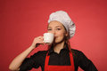 Beauty young cook with coffee portrait of or another hot drink Royalty Free Stock Photography