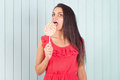 Beauty Young funny woman, girl Eating colourful lollipop. Royalty Free Stock Photo