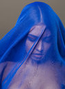 Beauty young islamic woman under veil, blue hijab on face close up, art Royalty Free Stock Photo