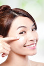 Beauty young woman applying cosmetic cream under eyes concept for eye and skin care asian Stock Photo