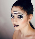 Beauty young woman with creative make up like zebra close Stock Image