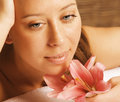 Beauty young woman with flower close up getting spa Stock Photos