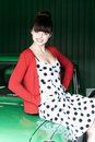 Beauty young woman on green car Royalty Free Stock Photo