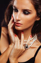 Beauty young  woman with jewellery close up, luxury portrait of rich real girl, party makeup Royalty Free Stock Photo