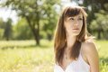 Beauty young woman in summer park Royalty Free Stock Photo