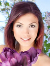 beauty young woman with a violet tulip flower Royalty Free Stock Photo