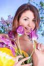 A beauty young woman with a violet tulip flower Royalty Free Stock Images
