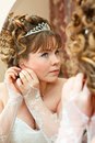 Beauty youngbride looking at mirror Royalty Free Stock Photos