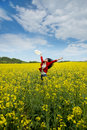 Beautyful asian model in canola field happy woman a Stock Photos