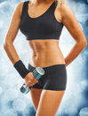 Beautyful female body with dumbbell Stock Photo